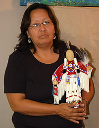 Mary White Country (woman) with beaded doll