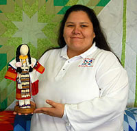 Robin Robertson (woman) holding beaded doll