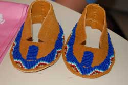 Pair of baby moccasins made by Master, Diane Combs.